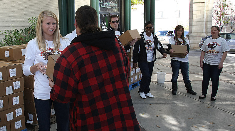 Volunteers for Lawyers Against Hunger help to distribute  700 turkeys and 500 food boxes to families and individuals in need in the Tulsa area.