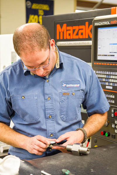Todd Kirouac mesures and files precision parts to exacting standards at Turbines, Inc in Altus, OK.