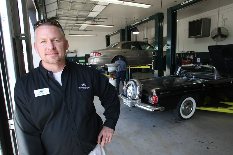 Christian Brothers Automotive franchisee Ray Adcock pauses for a photo at the companies south Tulsa location.