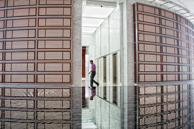 An employee walks past the elevators in the new Devon tower.