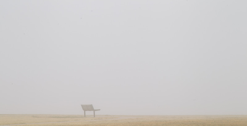 Thick fog at Hefner lake. A bench just a few feet from the shore line.