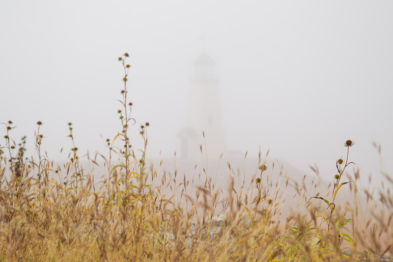 The light house at Hefner lake can barely be seen through the fog.