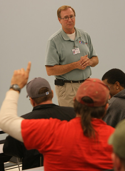 Owner of Air Assurnace Mike Rampey answers questions during the Business excellence Trade Show.
