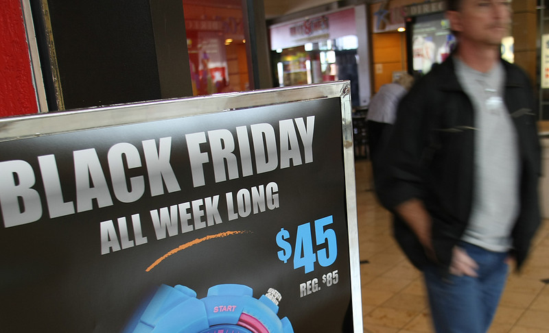 Black friday advertisements confront shoppers through out  the Woodland Hills Mall in Tulsa.
