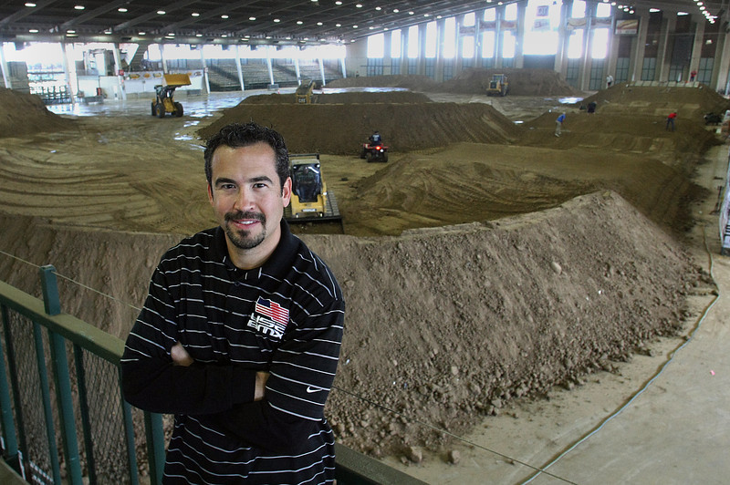John David, CEO of USA BMX, pauses for a photo in front of the track being constructed at the Quick Trip Center in Tulsa.