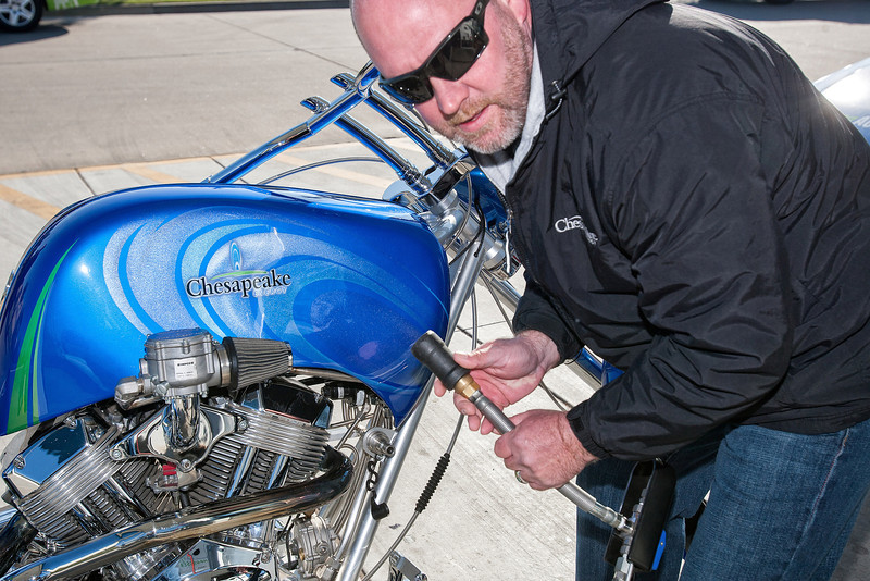 Rick Simpson refuels Chesapeake's CNG motorcycle built by Orange County Choppers.