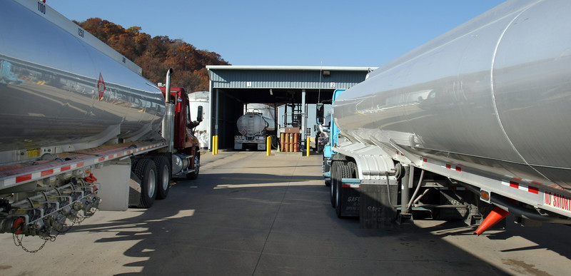 Trucks line up at the Magellan fuel distribution racks in west Tulsa to take on their load gasoline.
