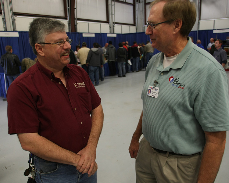 Tony Sheeley of Vattorot college chats with the owner of Air Assurnace Mike Rampey during the Business excellence Trade Show held at  Air Assurance in Broken Arrow.