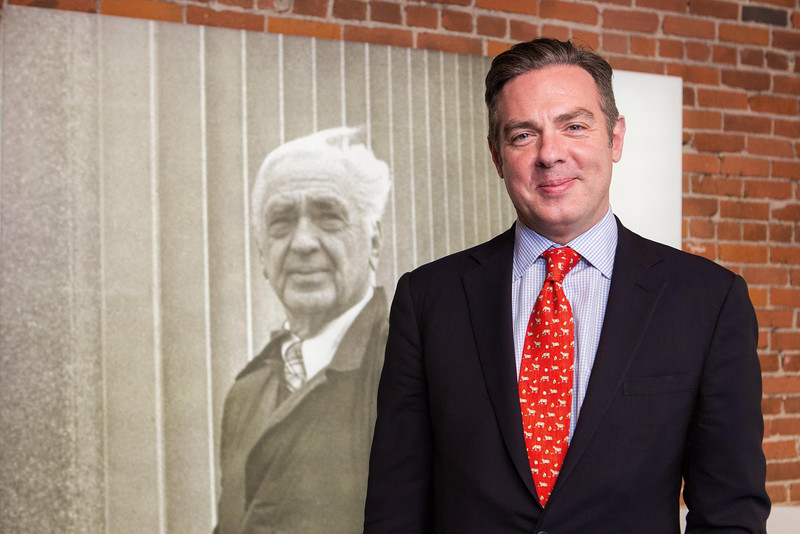 Christian Keese in front of a portrait of his grandfather, John Kirpatrick, dedicated at Lyric Theater.
