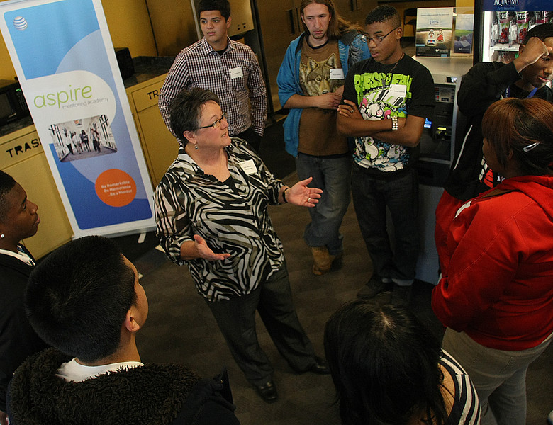 AT&T area manager chats with Junior Achievement students during a tour of the facilities in Tulsa.