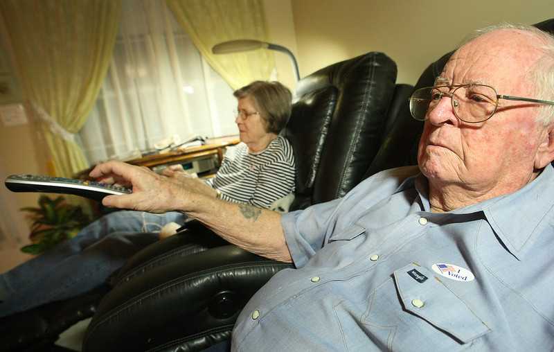 Bixby residents Betty and Red Stevenson check election results on television as the polls close in Oklahoma.