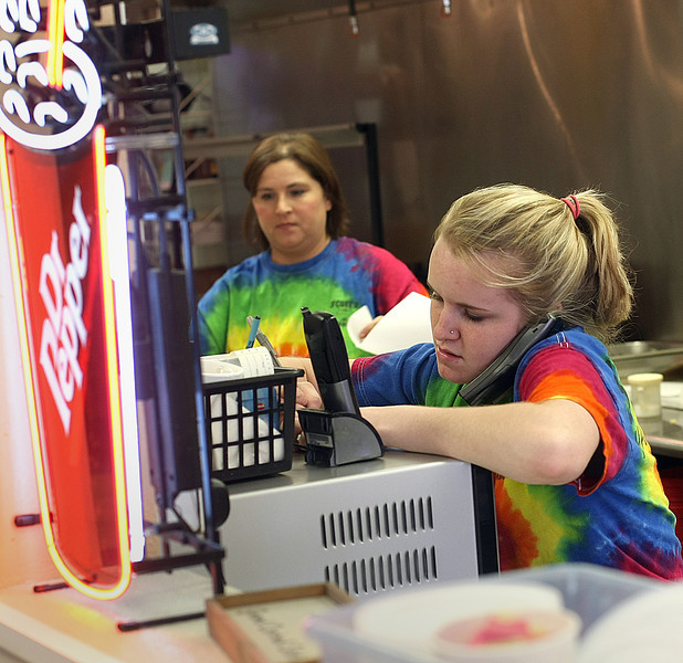Tonya Ladd cooks as Jennifer Merkt takes a to go order at Scott's Hamburgers in Bixby.