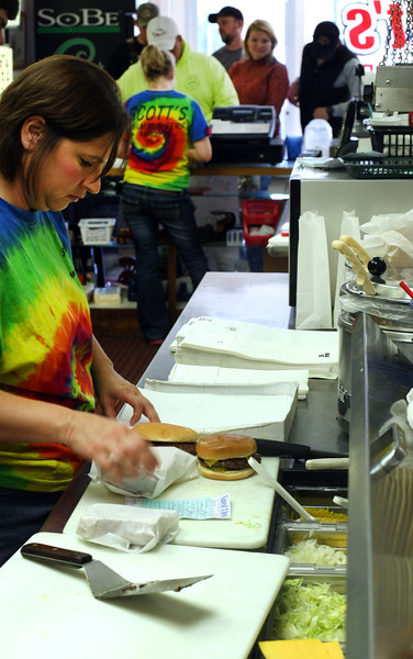Tonya Ladd cooks as Jennifer Merkt takes orders at Scott's Hamburgers in Bixby.