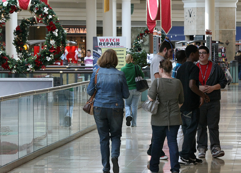 Shoppers stroll through the Woodland Hills Mall in Tulsa.