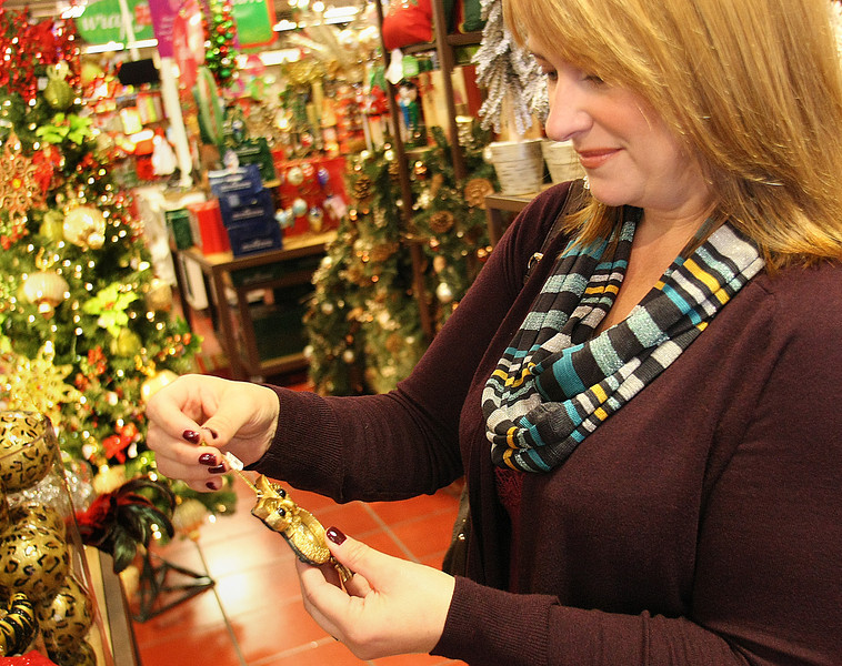 Cindy Rapacki browses through the Pier 1store at the Utica Square Shopping center.