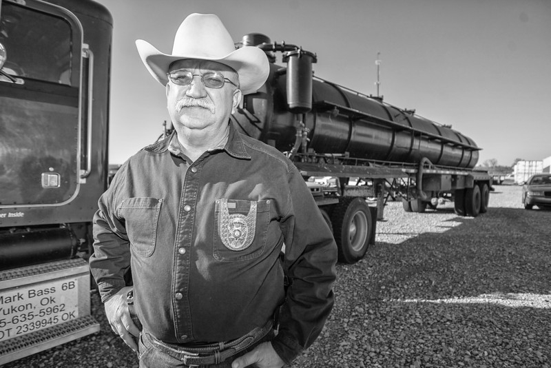 Canadian County sheriff Randell Edwards stands in front of a confiscated truck used for crude oil theft.