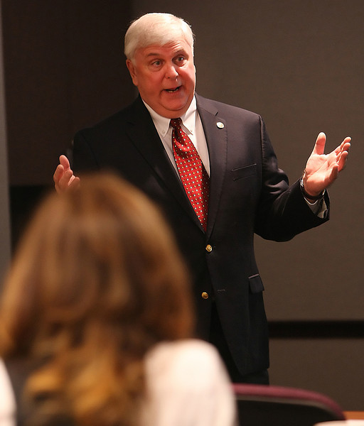 Mike Rhoads speaks at the Tulsa Metro Chamber Health Care Forum: about what costs may arise from the Affordable Care Act.