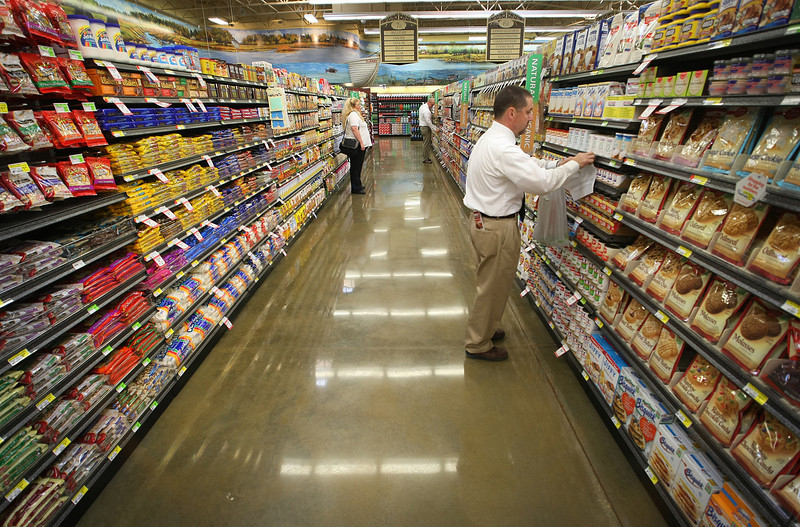 Bill Damrron readies Oklahoma's newest Reasors grocery store in Bixby for its grand opening.