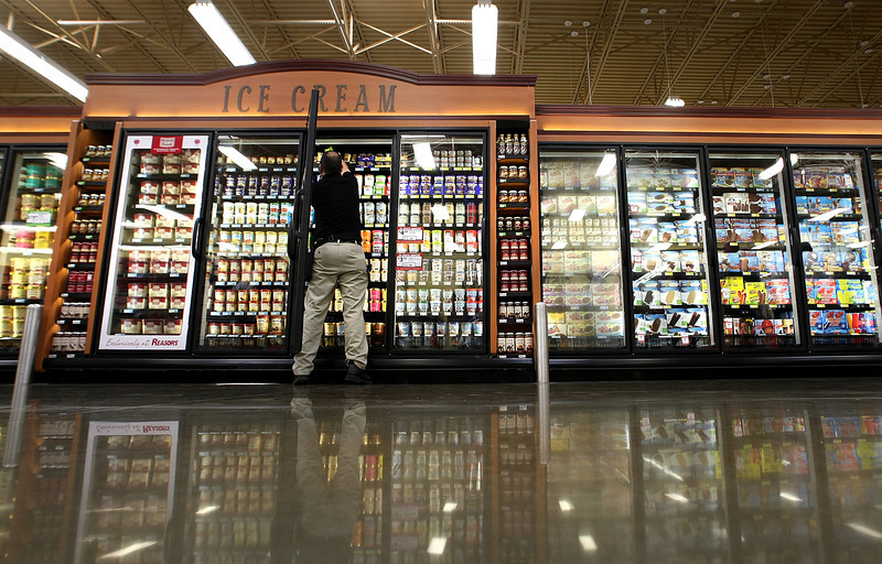 Jeff Guey of Nestlee Foods readies Oklahoma's newest Reasors grocery store in Bixby for its grand opening.