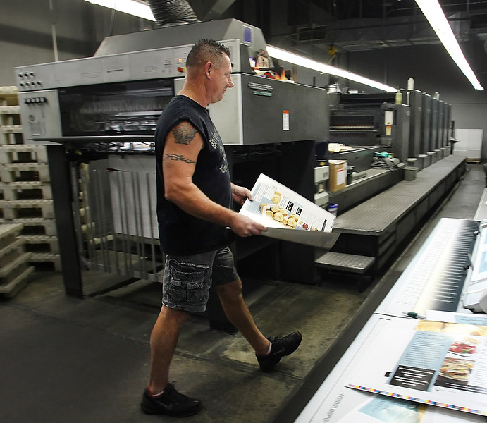 Pressman Lance Hendricks works on a packaging print job currently underway at Professional Image Packaging in Tulsa.