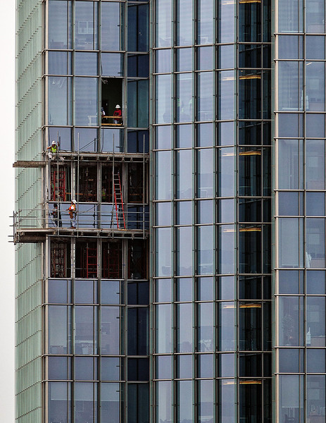 Some final exterior construction midway up the east side of the Devon Tower.