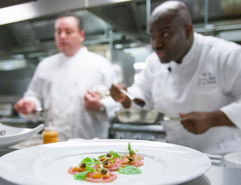 Executive Chef Patrick Williams and Chef Andrew Black prepare dishes on the opening day of Vast, located on the 49th and 50th floor of the Devon tower. Chef Black is VP of Culinary for Vast.