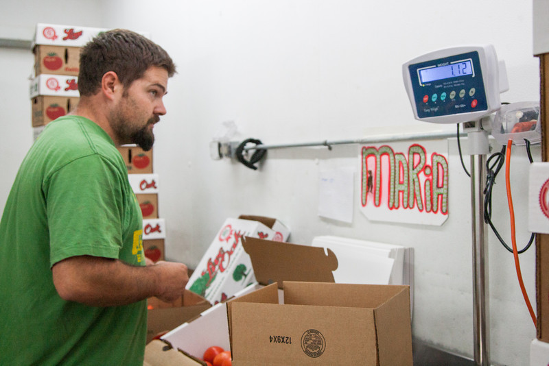 Aaron Griffith weighs boxes of produce at Buddy's Produce in Midwest City.