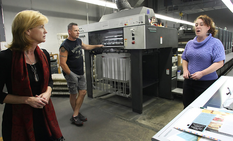 Cynthia L. Calvert Copeland, Lance Hendricks and Jennifer Giebel discuss a packaging print job currently underway at Professional Image Packaging in Tulsa.
