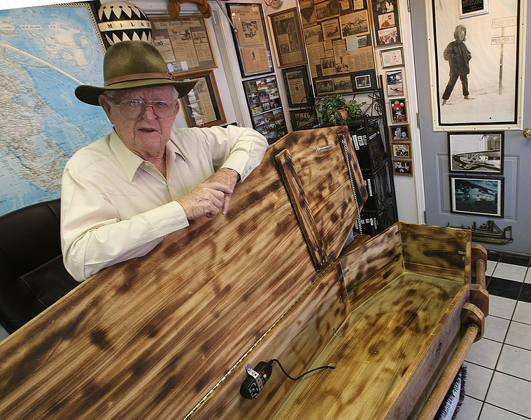 Red Stevenson shows off his coffin desk at his office in downtown Bixby.