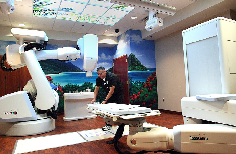 Radiation Therapist Ted Martin readys the CyberKnife for a patient at the Cancer Treatment Centers of America in Tulsa.