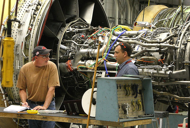 Mechanics at American Airlines work on a turbine engine at the maintenance base in Tulsa.