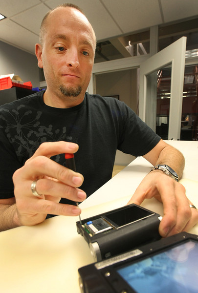 Trebor Fisher assembles a wrist wearable camera monitor at Tactical Electronic in Broken Arrow.