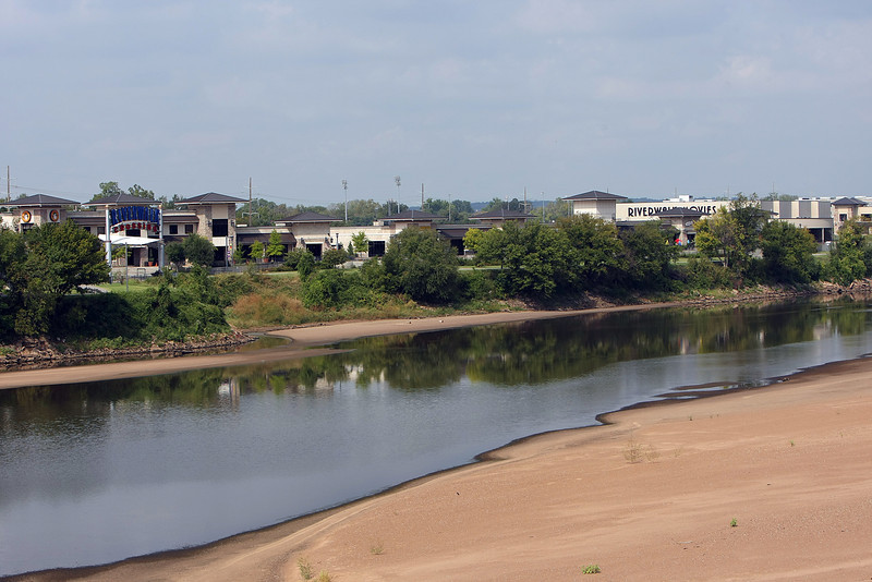 The Arkansas River flows past the Riverwalk crossing shopping center in Jenks.