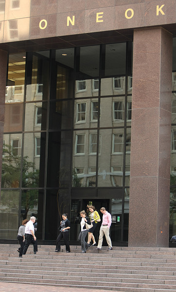 Employees enter the OneOk headquarters in Tulsa.  Private crude transport company Barcas LLC filed a $10 million lawsuit against Oneok Partners LP claiming breach of contract over the Bakken Express Pipeline project. Barcas claims in the suit Oneok Partners cut the company out of the deal.