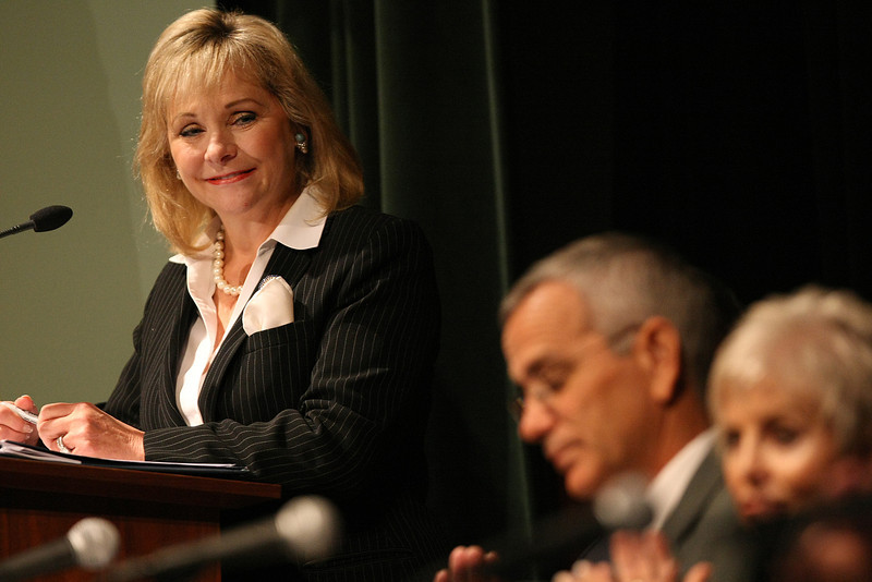 Governor Mary Fallin looks at members of her cabinet during the recent Town Hall Meeting in Tulsa.
