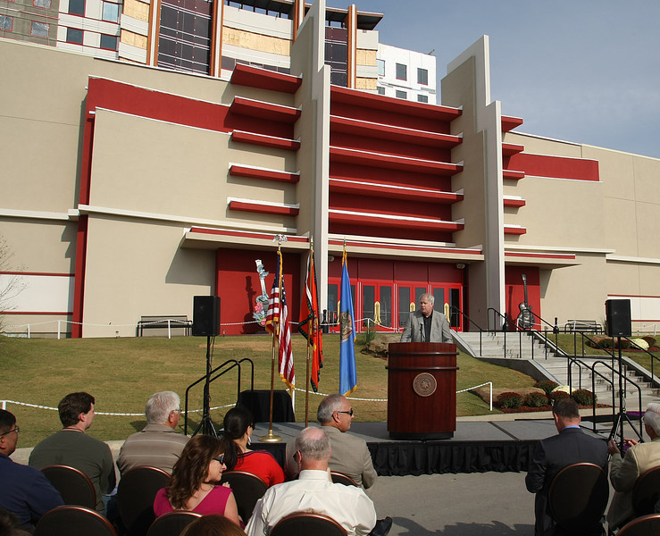 Cherokee Nation Businesses Executive Vice President Shawn Slaton, speaks at the dedication of the new wing at the Hard Rock Casino in Catooosa.