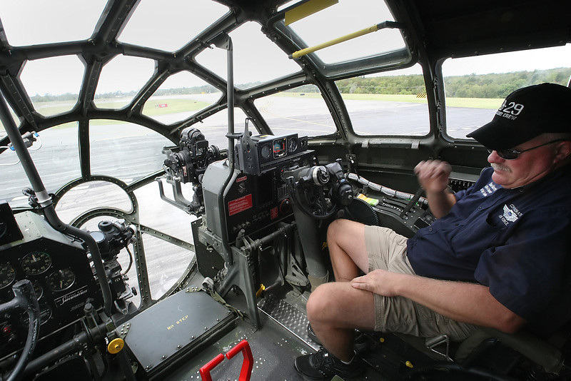 Shad Morris, Pilot of the Commemorative Air Forces' World War II Boeing B-29 Superfortress FIFI, sits in the cockpit of the aircraft after arriving in Tulsa.  The aircraft is touring the US selling rides to help fund the maintenance on the plane.