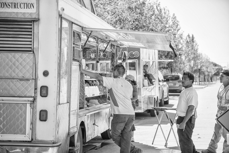 Food service trucks lines up on the west side of the Myriad Gardens at lunch time.
