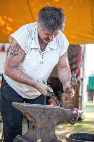 Blacksmith Jim Stubbs demonstrates his skill by making horse shoes at the Oklahoma State Fair.