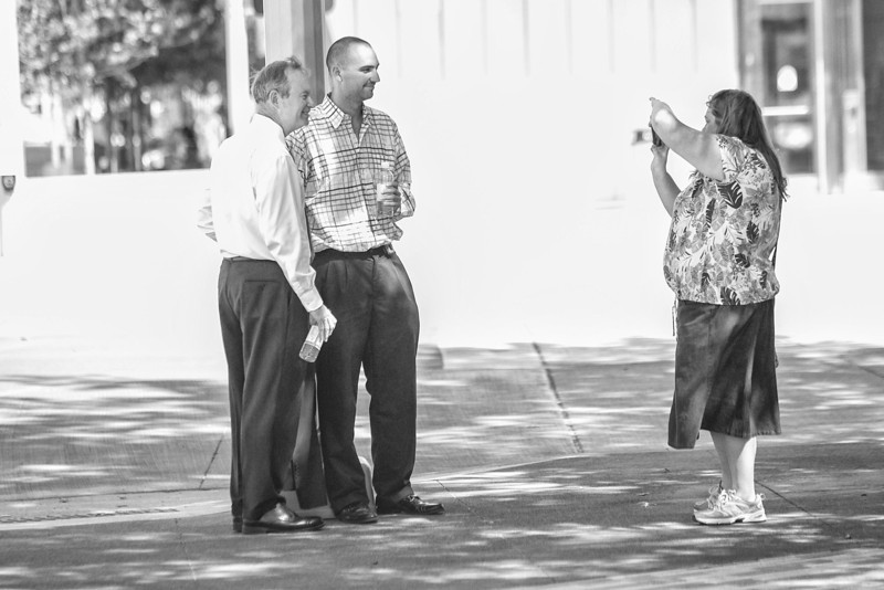 Mayor Mick Cornet stops to take a picture at the Myriad Gardens.