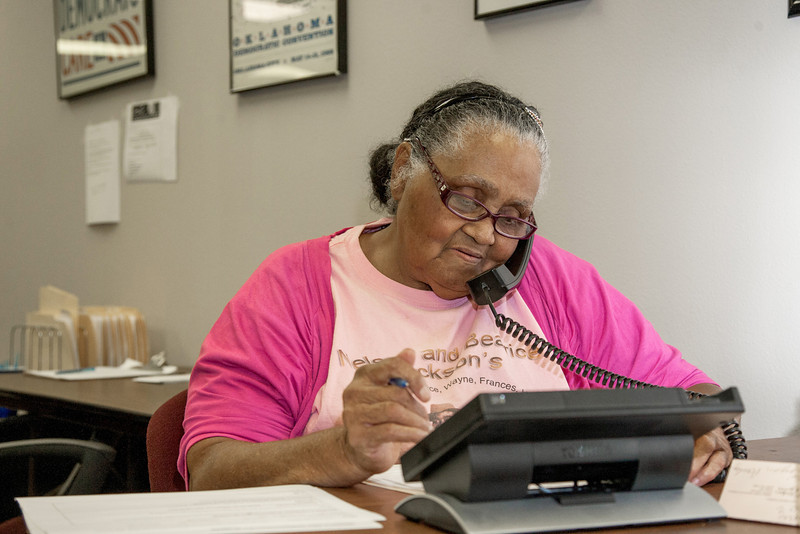 Evelyn Abdullah makes calls as a volenteer at the state Democrat headquaters.