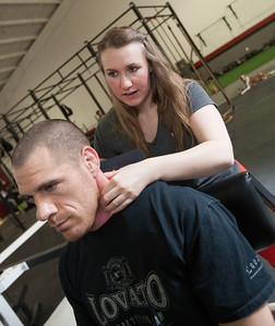 Jesslynn Stull works with a client at The Wellness CO-OP at 14416 N Lincoln Blvd in Edmond, OK.