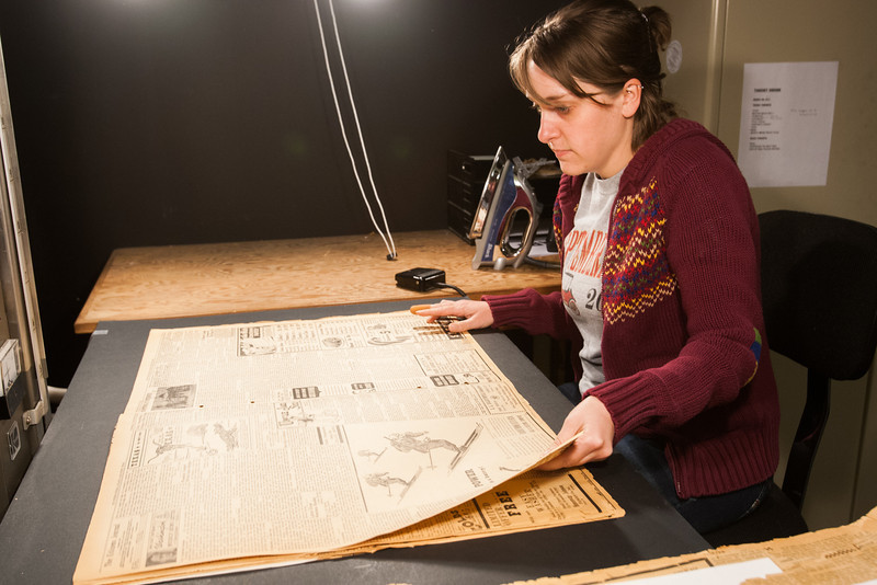 Sarah Biller take digital images of historic newspapers at the Oklahoma History Museum.