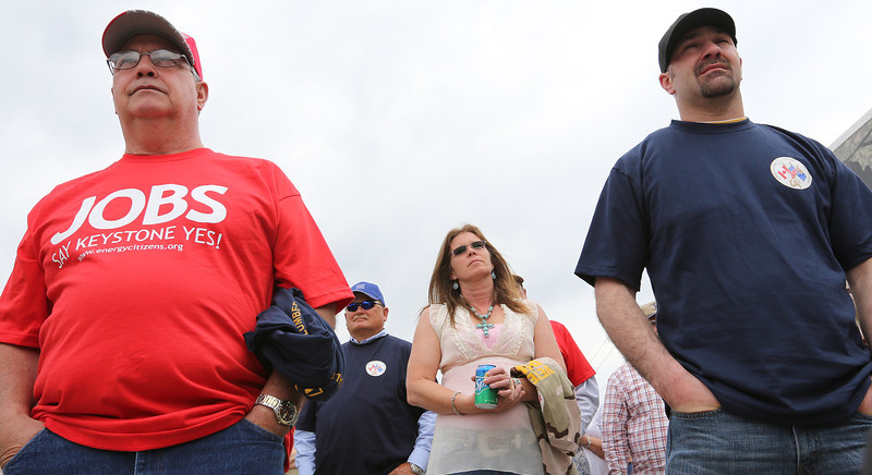 Supporters listen to a speech at a rally held in Tulsa Tuesday to support the Keystone XL pipeline.