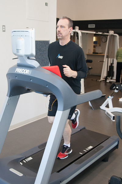 Jon Hamm works out in the gym at OMRF, where he works. Without the convienance of an onsite gym Mr. Hamm says he would not have time to work out.