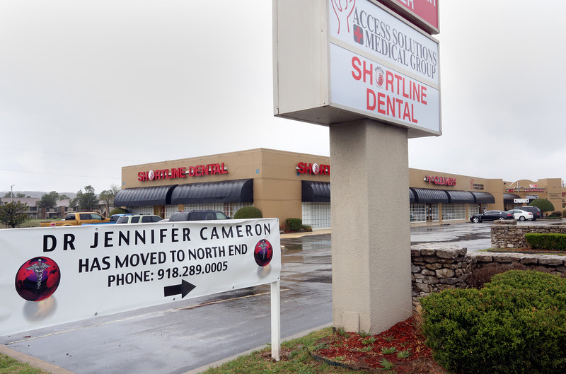 Signage in front of Access Solutions Medical Group announces the new office for Dr. Jennifer Cameron.