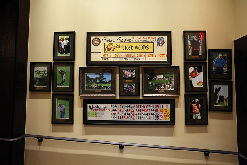 Scorecards and photo hang on the walls  near the pro shop at the Tulsa Hills County Club.
