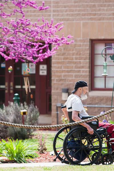 A resident outside at the Norman Veterns Center.