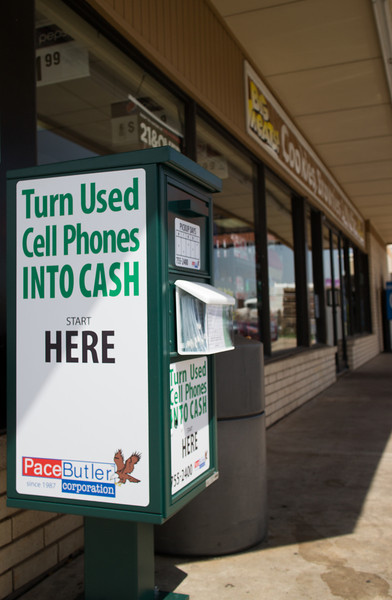 At 7/11 through out the Oklahoma City metro are cell phone buy back drop off points.