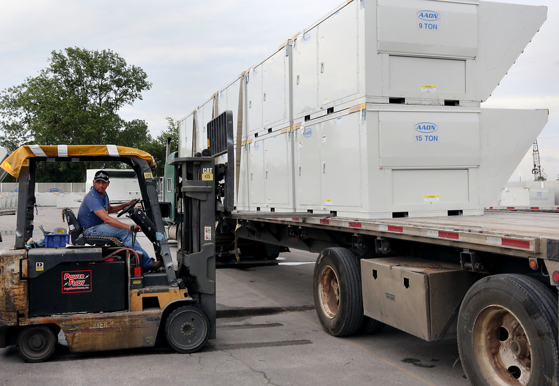 An AAON employees loads industrial air-conditioning units for shipment from the its Tulsa plant.  AAON announced its operating results for the second quarter, sales and earnings during the quarter were record highs for any quarter in the Company's history.